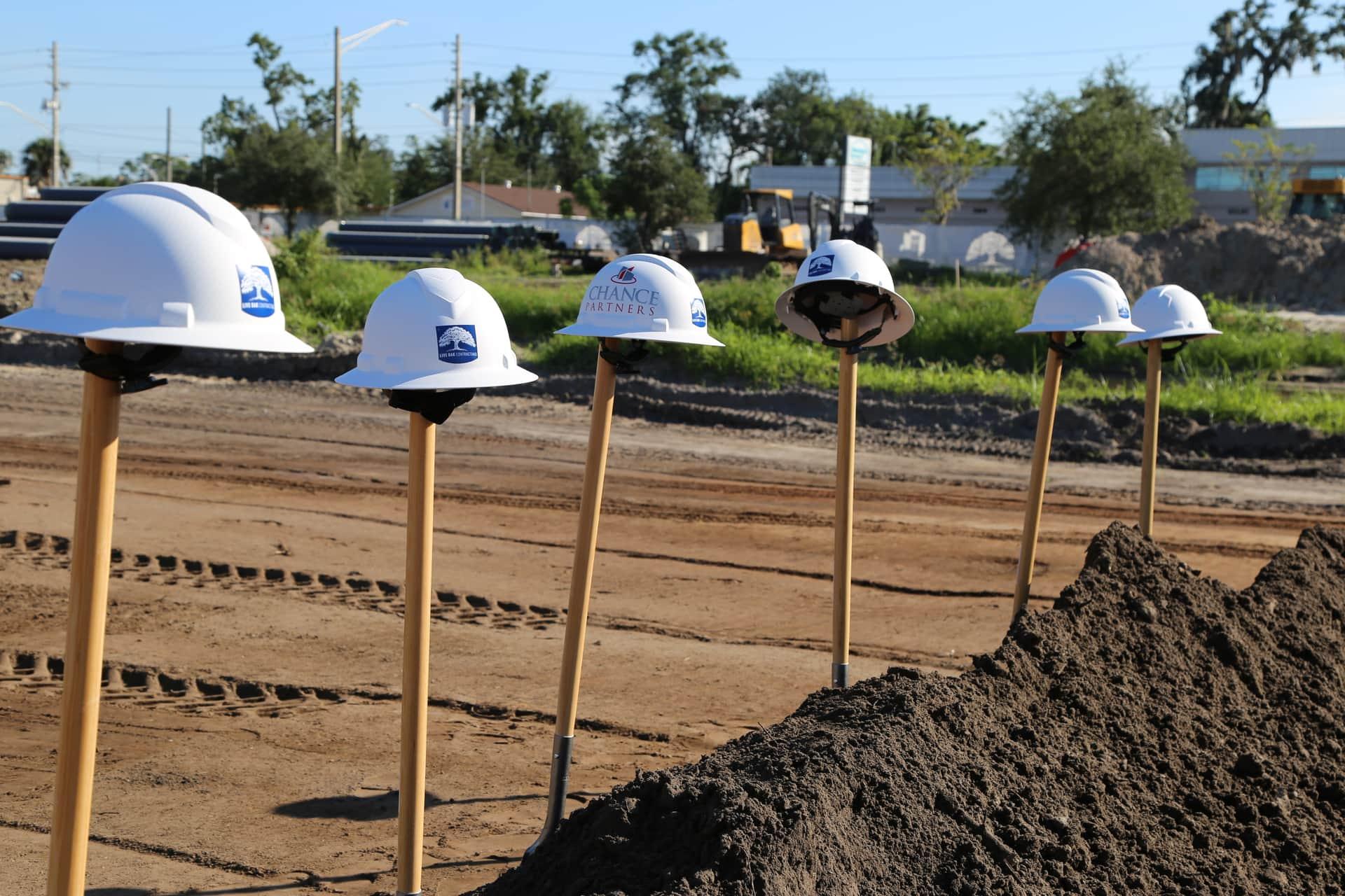 helmets on shovels at construction site