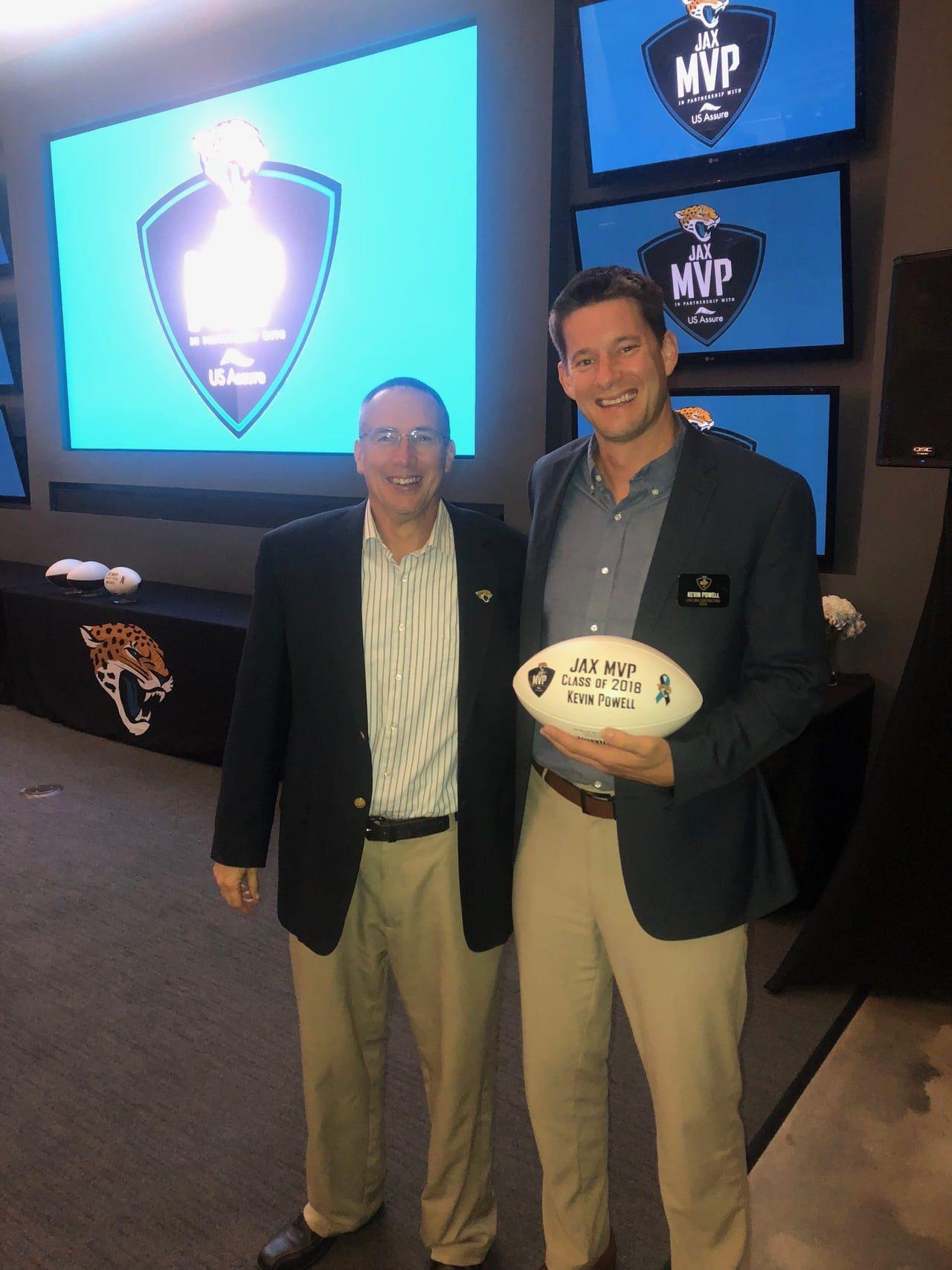 two men holding football