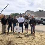 group breaking ground ceremony at construction site