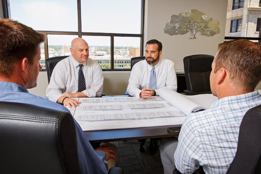 men discussing construction plans