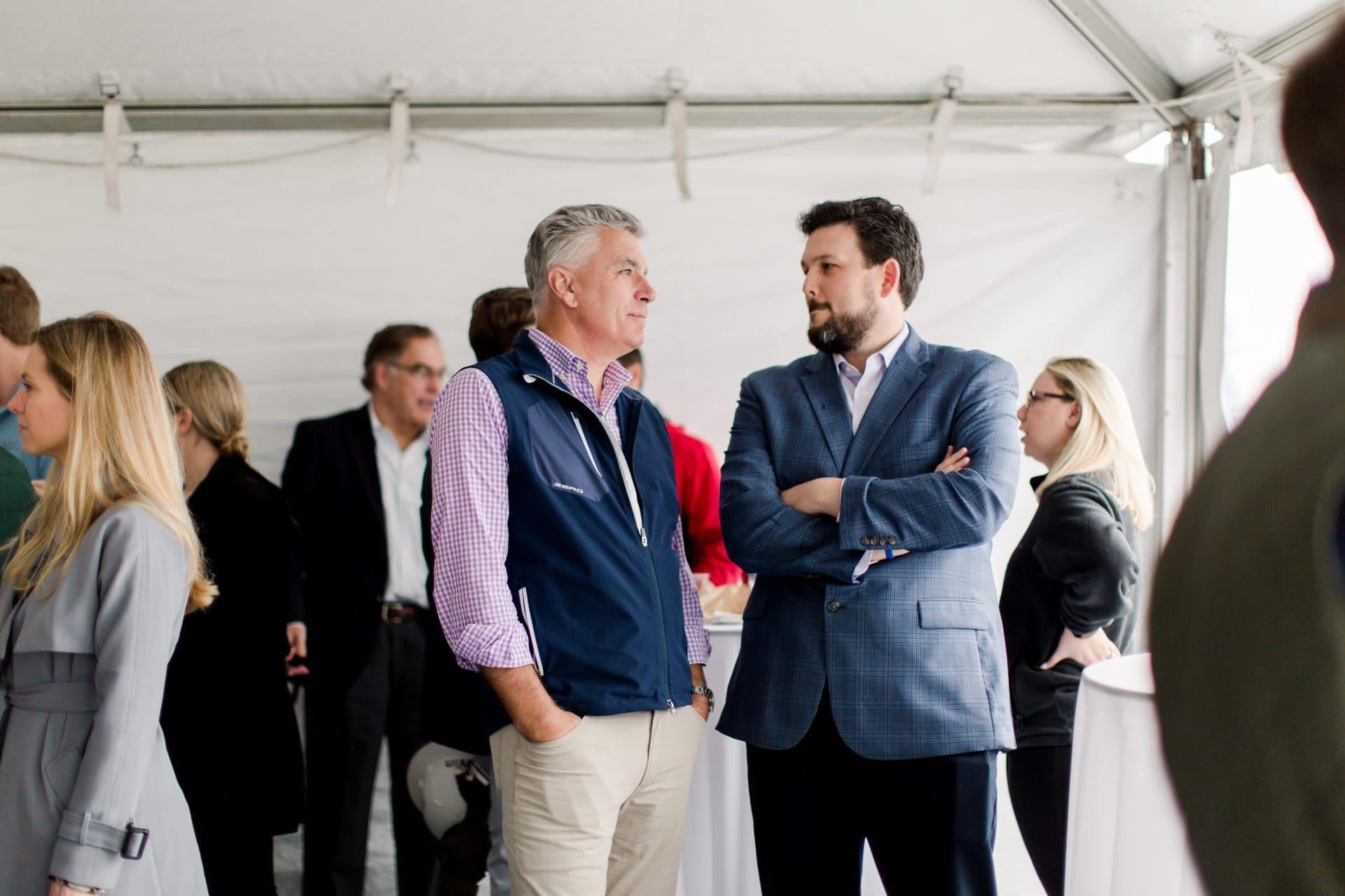 two men conversation event
