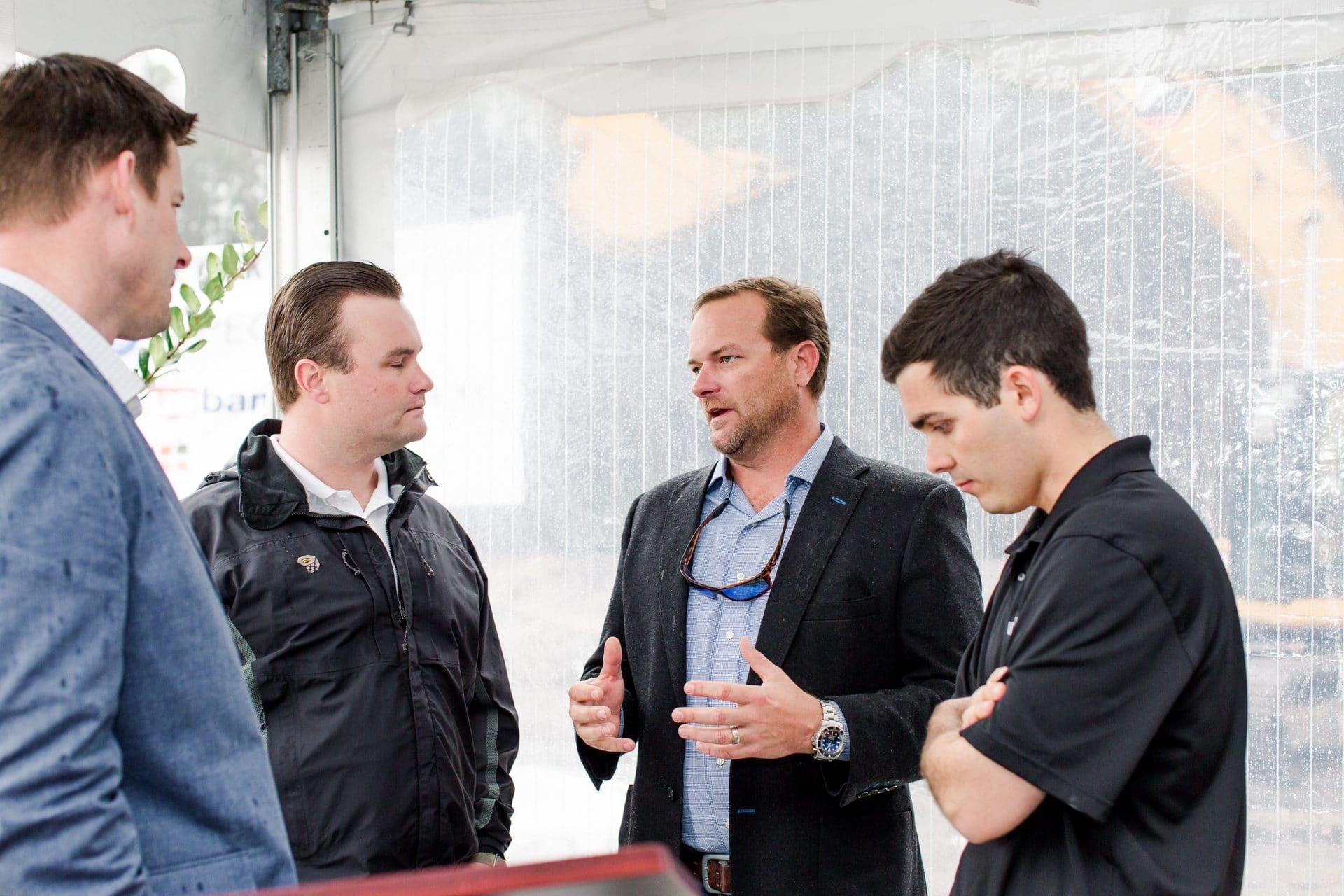men speaking in group