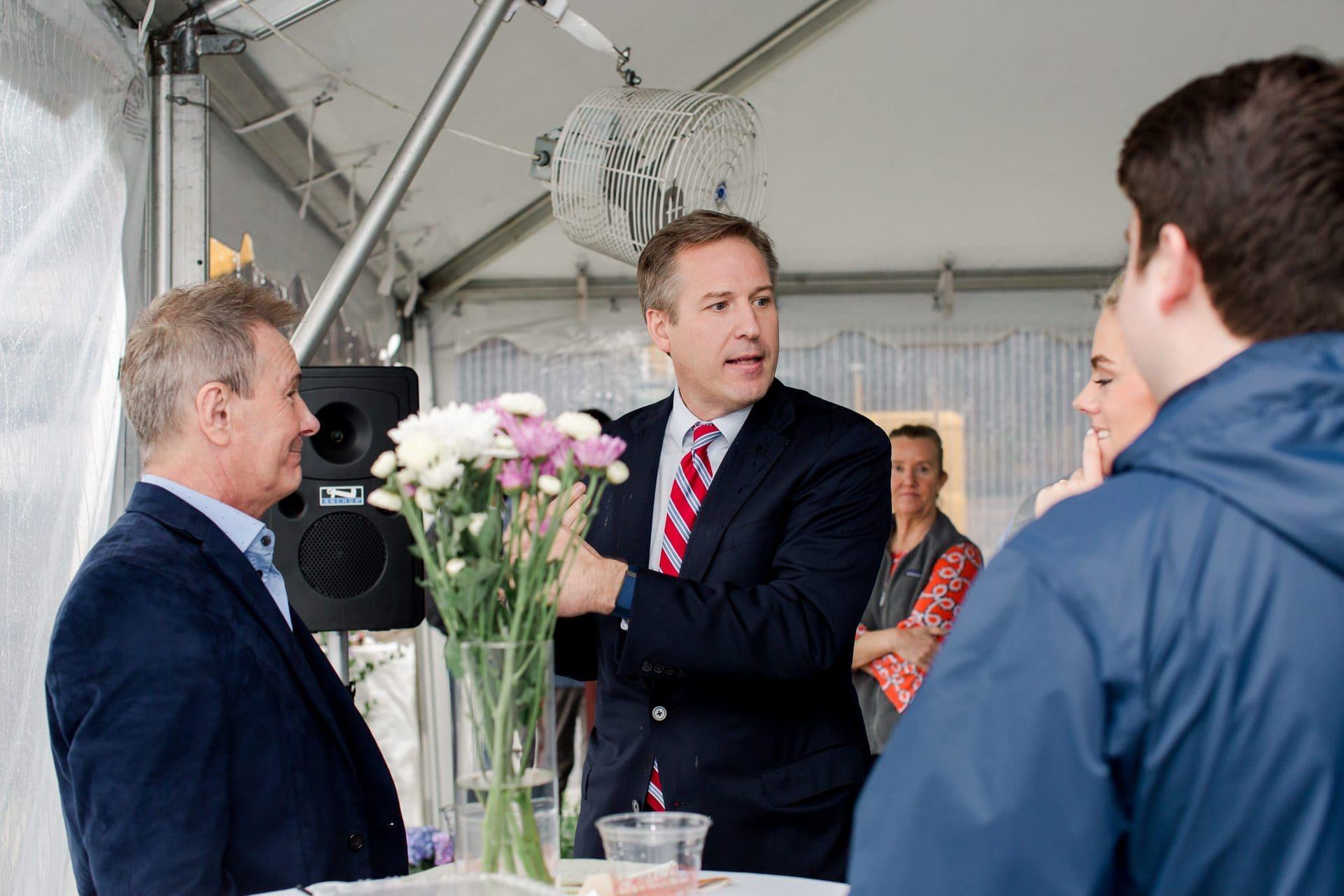 men talking at event