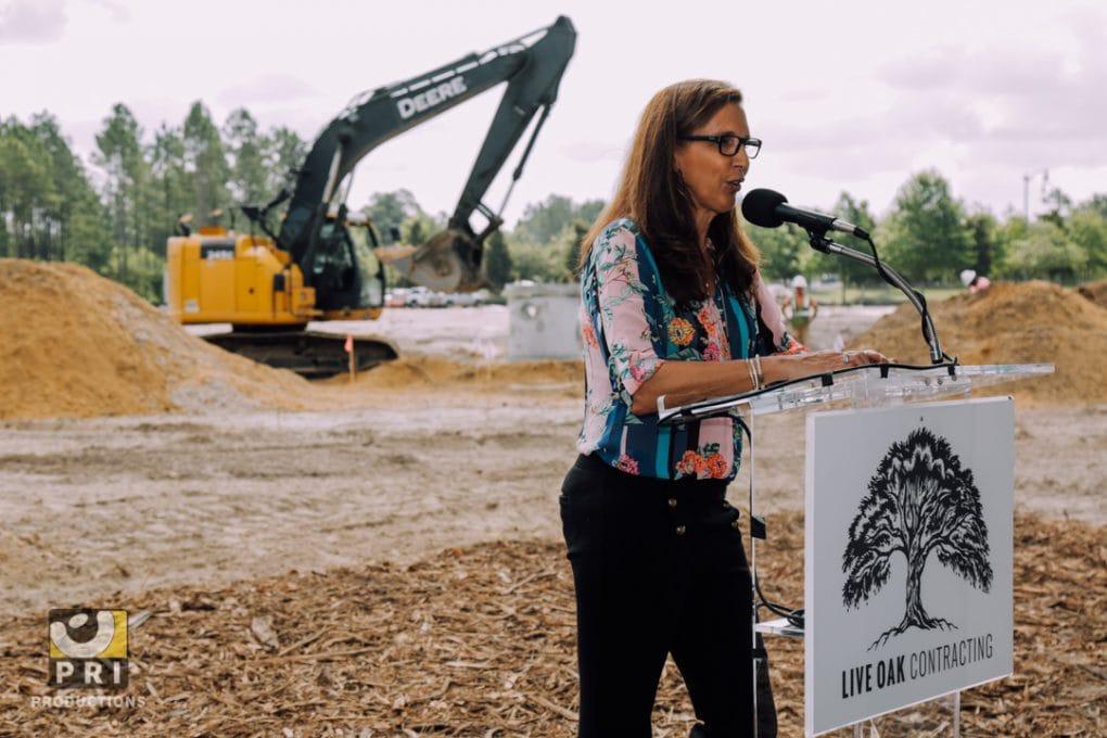 woman speaking at podium construction