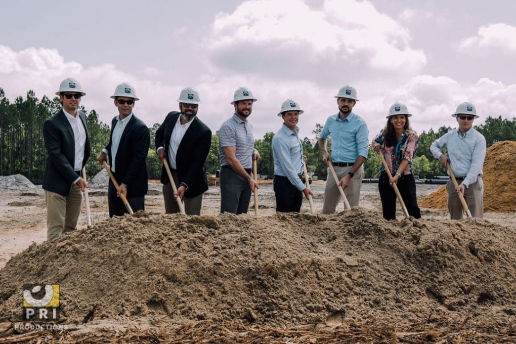team breaking ground new construction project