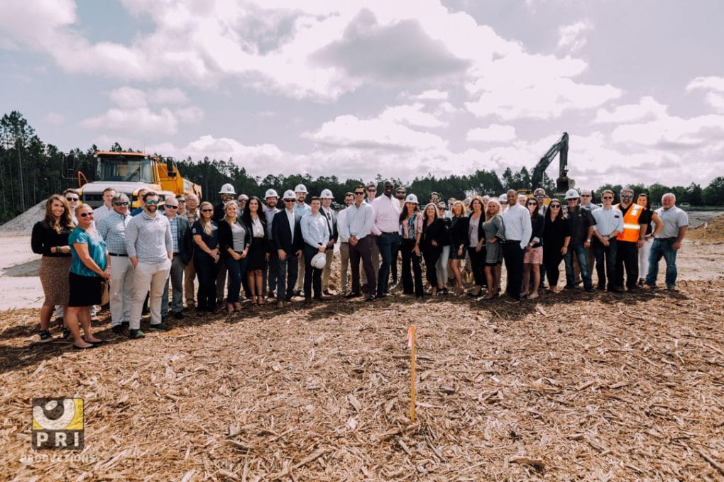 group of people standing in front of construction site