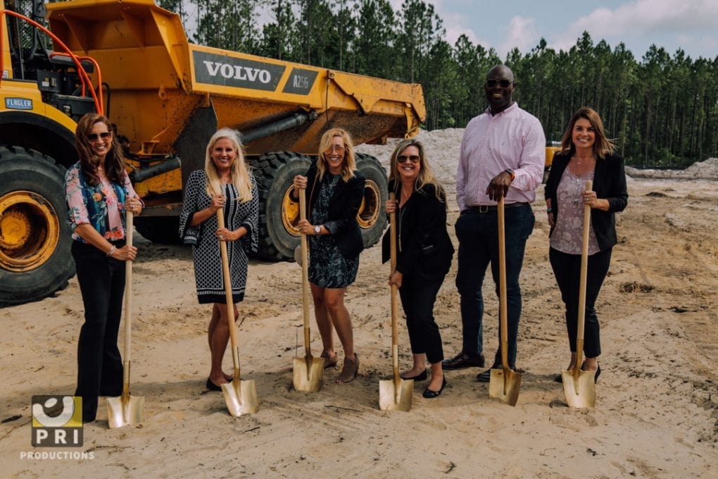 team with shovels at construction site