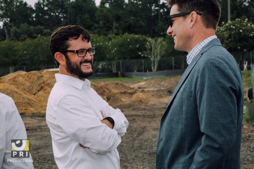 two business men laughing