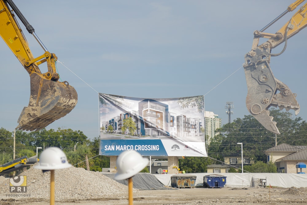 cranes holding new construction poster