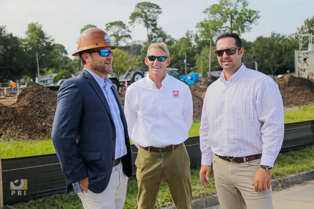 three men at construction site