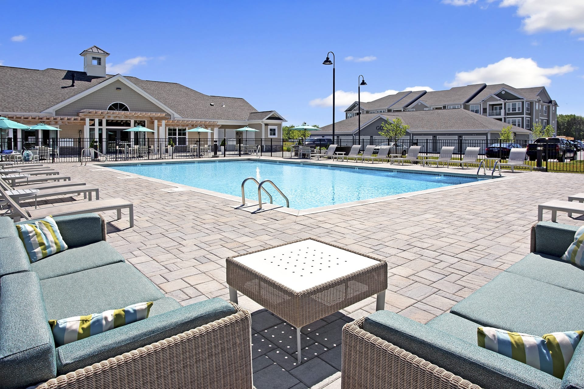 apartment complex pool and outside furniture